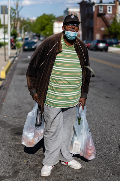 Al Johnson, 60, poses for a portrait outside of the Harvey Johnson Towers in Baltimore, Md. on May 12, 2020.