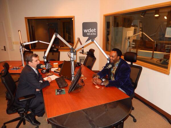 . Marcus Glenn (right) is interviewed by Craig Fahley at WDET-FM (101.9). Glenn told Fahle that he views carrying the torch of other African-American artists as a responsibility.Photo courtesy of Park West Gallery