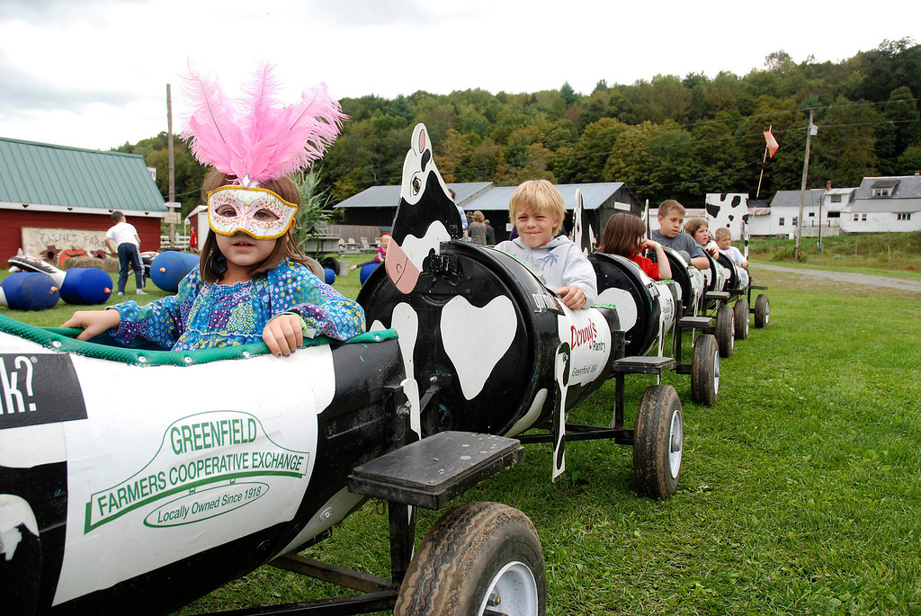 . Kayla Rice/Reformer Children ride the cow train at Gaines Farm in Guilford.
