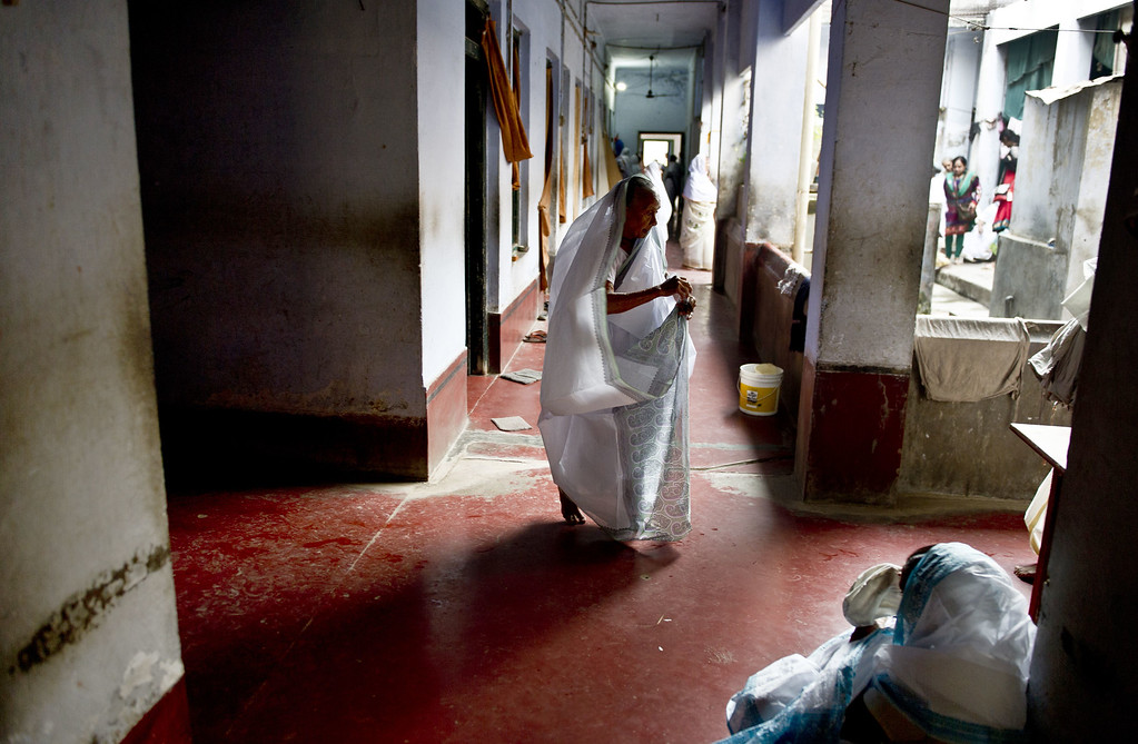. An Indian widow wears a brand new sari as she walks through her home in the Mahila Ashram in the northern Indian town of Vrindavan on October 21, 2014. ROBERTO SCHMIDT/AFP/Getty Images