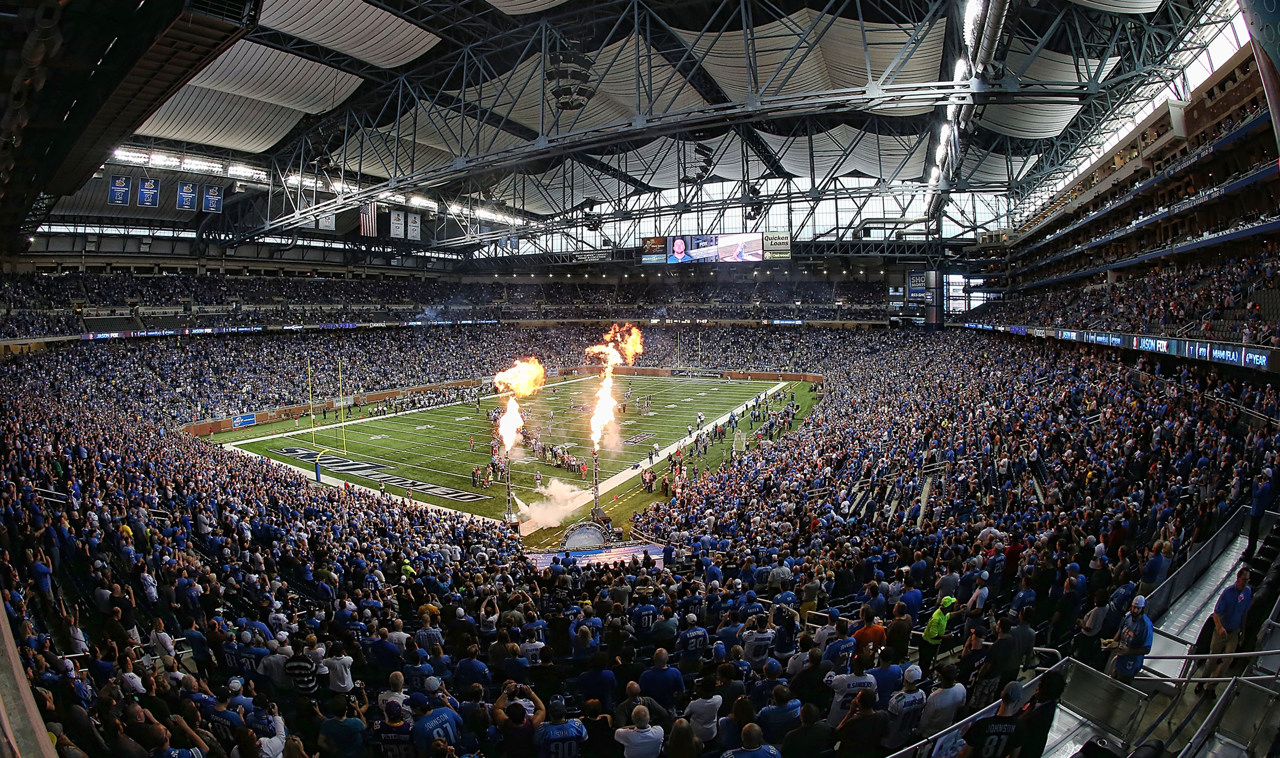 . Flashpots explode adjacent to the Ford Field playing field during the introductions of the players prior to the start of the Vikings-Lions game.  (Photo by Leon Halip/Getty Images)