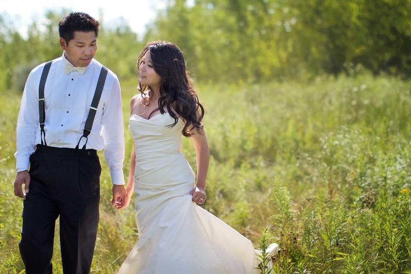 Bride & groom in field_lo.jpg