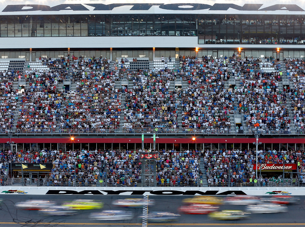 . DAYTONA BEACH, FL - JULY 06:  Cars race down the frontstretch past the gransstand during the NASCAR Sprint Cup Series Coke Zero 400 at Daytona International Speedway on July 6, 2013 in Daytona Beach, Florida.  (Photo by Scott Halleran/Getty Images)