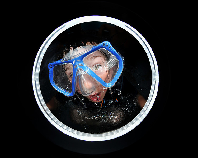 Geno coming up for air after diving under the water