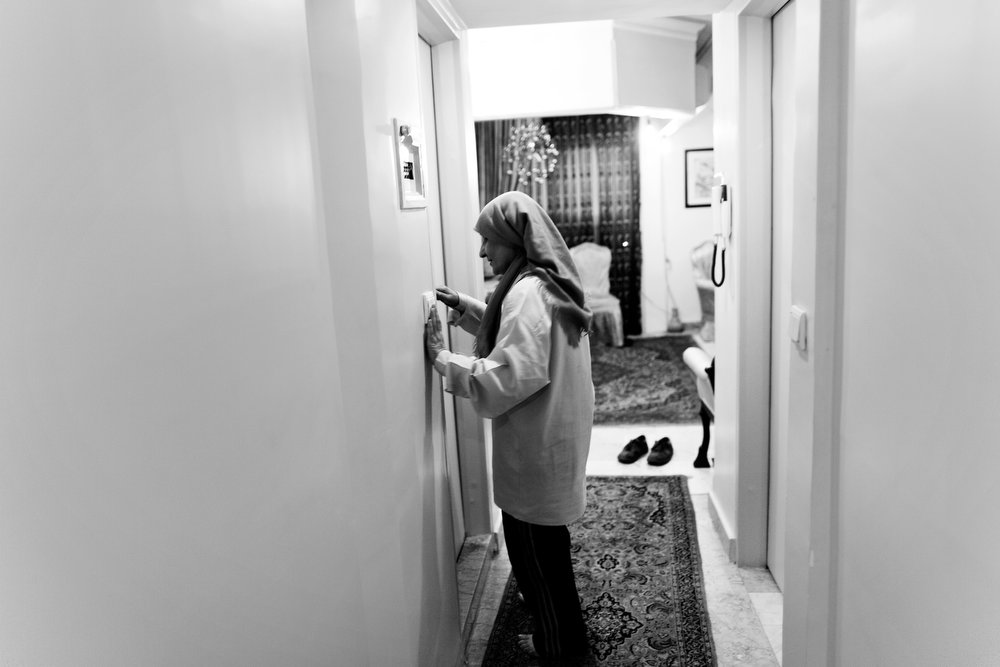. Iranian Soheila Mehri, who suffers from breast cancer, walks to the bathroom in their house in Tehran on March 3, 2013.  AFP PHOTO/BEHROUZ MEHRI