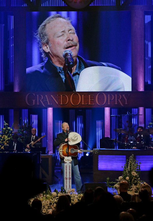 """. Alan Jackson sings \""""He Stopped Loving Her Today\"""" to close the funeral for country music star George Jones in the Grand Ole Opry House on Thursday, May 2, 2013, in Nashville, Tenn. Jones, one of country music\'s biggest stars who had No. 1 hits in four separate decades, died April 26.  (AP Photo/Mark Humphrey, Pool)"""