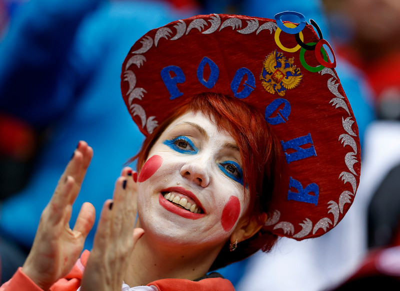. A hockey fan cheers on Russia against Norway in the first period of a men\'s ice hockey game at the 2014 Winter Olympics, Tuesday, Feb. 18, 2014, in Sochi, Russia. (AP Photo/Mark Humphrey)