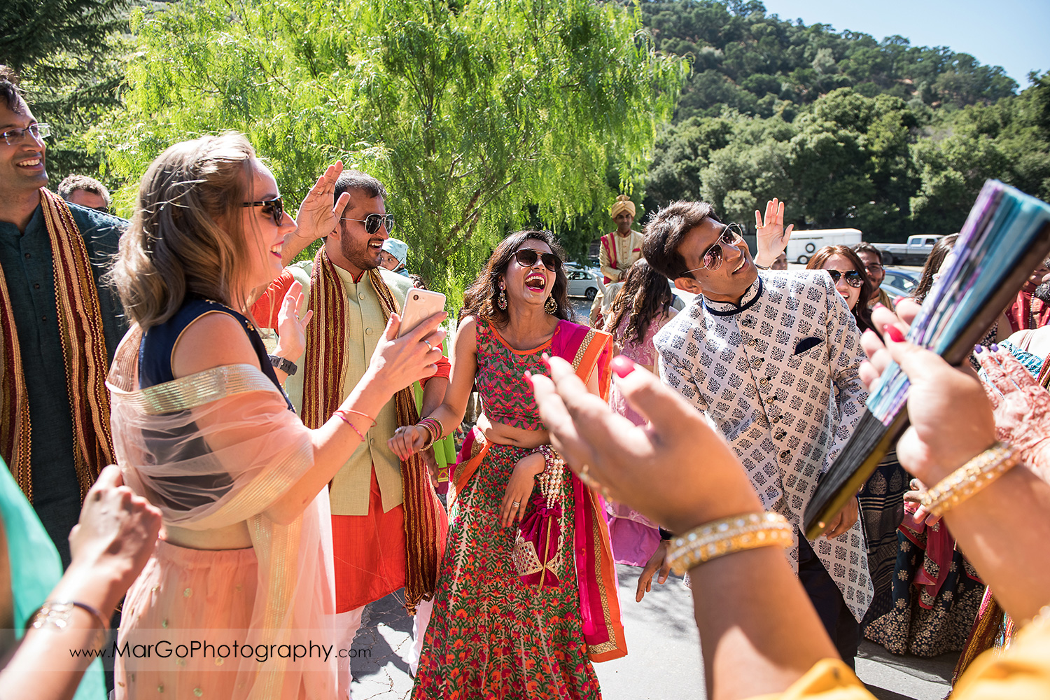 Indian bridal pary laughing during Baraat Swagat at Elliston Vineyards in Sunol