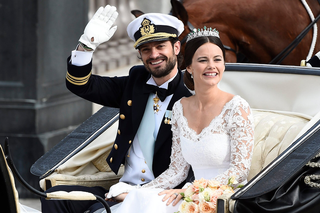 . Sweden\'s Prince Carl Philip sits with his bride, Sofia Hellqvist in a carriage, after their wedding ceremony,  in Stockholm, Sweden, Saturday, June 13, 2015.  The only son of King Carl XVI Gustaf and Queen Silvia has married his Swedish fiancee in a lavish ceremony in Stockholm. Prince Carl Philip and the former reality starlet and model Sofia Hellqvist, 30, tied the knot Saturday at the Royal Palace chapel before five European queens, a Japanese princess and dozens of other blue-blooded guests.  (Mikael Fritzon/ TT via AP)