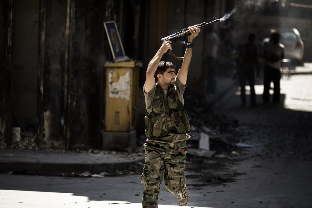 Description of . A Syrian rebel fires towards a position held by regime forces during clashes in the northern city of Aleppo on September 14, 2012. Syrian regime forces used fighter jets and helicopter gunships to pound the city and province of Aleppo, where fierce clashes raged around a military airport, monitors said. MARCO LONGARI/AFP/Getty Images