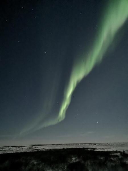 Aurora Borealis from tundra lodge parked near Hudson Bay