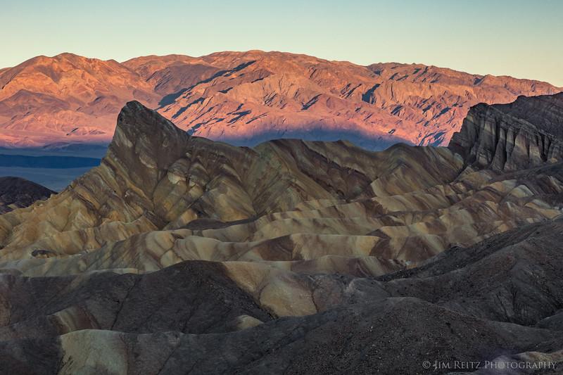 Sunrise on distant mountain range - Zabriskie Point, Death Valley National Park