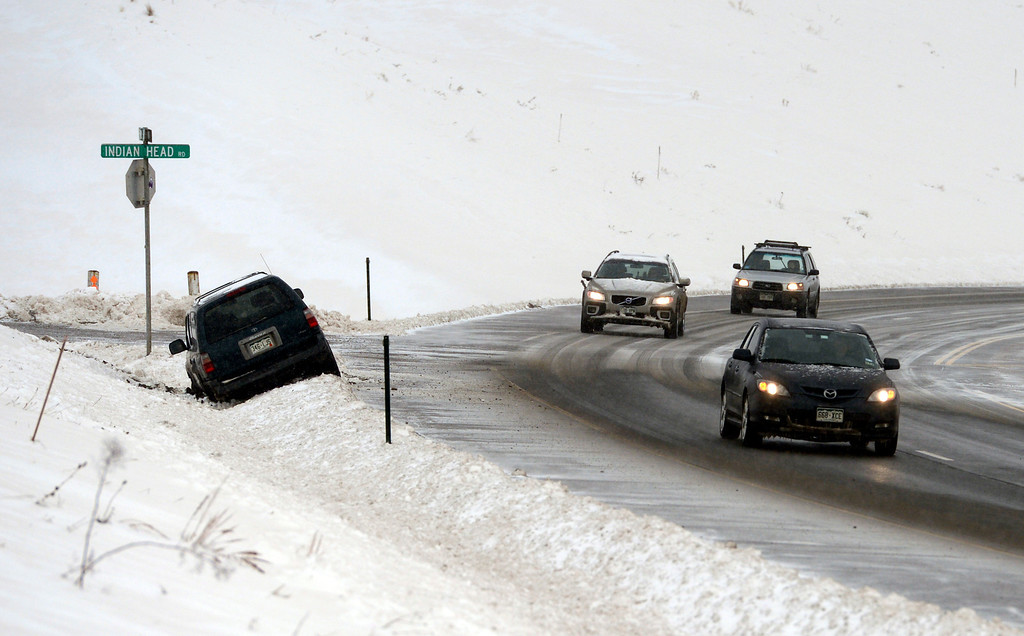 . ARVADA, CO-April 17, 2013: Black ice got the best of a driver on Highway 93 near Arvada, April 17, 2013. Snow continues to fall as a spring storm hits much of Colorado. (Photo By RJ Sangosti/The Denver Post)