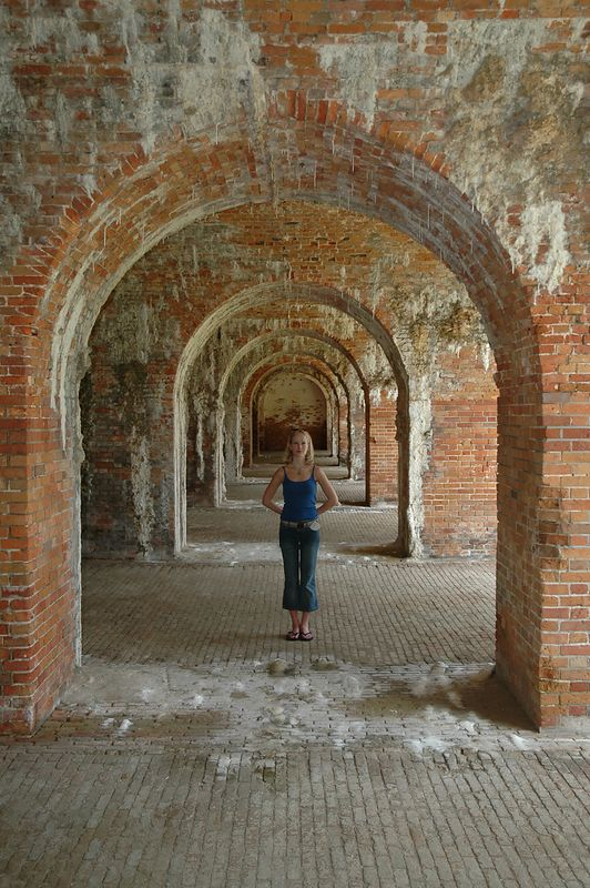Kate in the arches at Fort Morgan.