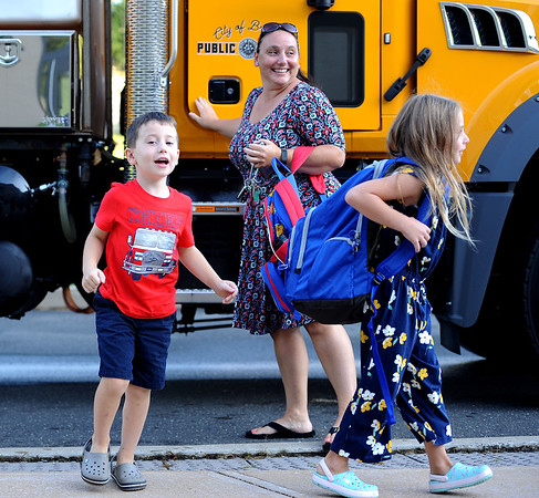 9/3/2019 Mike Orazzi | StaffrNicole Nass with her son Caleb and daughter Kylie after Caleb got a ride to school from Public Works to the West Bristol School on the first day of school Tuesday morning in Bristol.