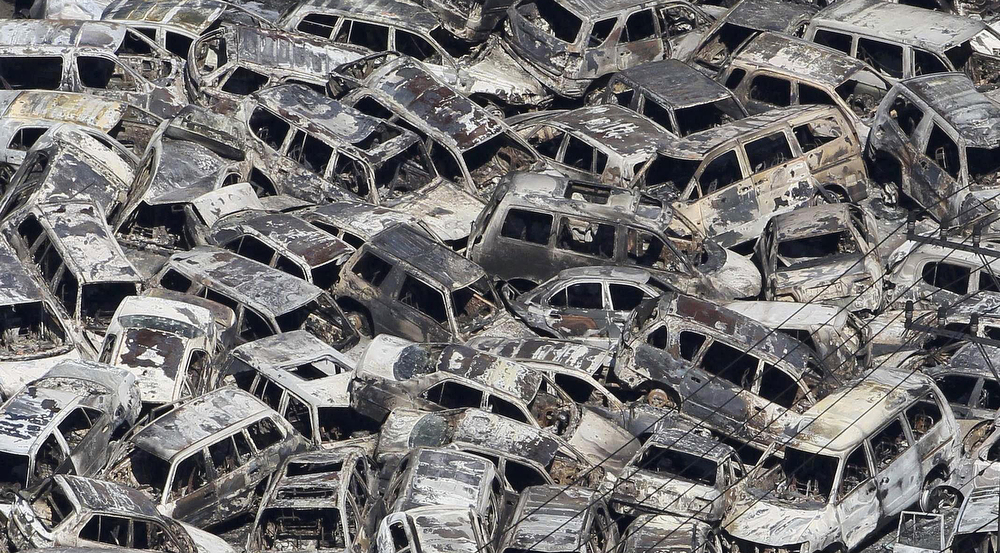 . In a picture taken on March 12, 2011 burnt out vehicles, that were parked for export, are piled in disarray at a port at Tokai village in Ibaraki prefecture after a tsunami. More than 1,000 people were feared dead and authorities warned a meltdown may be under way at a nuclear plant after a monster tsunami devastated a swathe of northeast Japan.   (YOMIURI SHIMBUN/AFP/Getty Images)