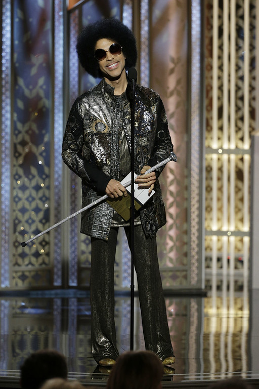 . BEVERLY HILLS, CA - JANUARY 11:  In this handout photo provided by NBCUniversal, Presenter  Prince speaks onstage during the 72nd Annual Golden Globe Awards at The Beverly Hilton Hotel on January 11, 2015 in Beverly Hills, California.  (Photo by Paul Drinkwater/NBCUniversal via Getty Images)