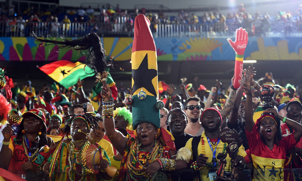 Description of . Ghana's fans cheer before the start of a Group G football match between Ghana and US at the Dunas Arena in Natal during the 2014 FIFA World Cup on June 16, 2014.  CARL DE SOUZA/AFP/Getty Images