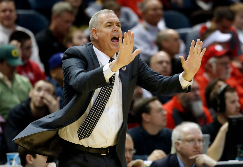 . BYU head coach Dave Rose directs his team during the first half of a second-round game in the NCAA college basketball tournament Thursday, March 20, 2014, in Milwaukee. (AP Photo/Jeffrey Phelps)