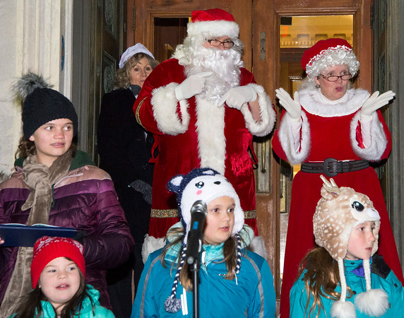 12/03/19 Wesley Bunnell | Staff The 68th annual Bristol Carol Sing and 29th annual Tree Lighting presented by Webster Bank and the Central CT Chambers of Commerce took place on Tuesday night outside to Webster Bank at 150 Main St. Santa & Mrs. Clause make their entrance behind the choir.