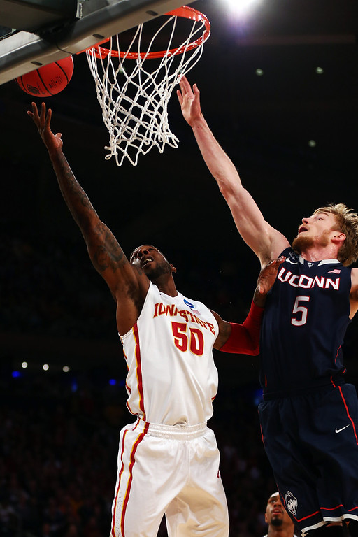 . DeAndre Kane #50 of the Iowa State Cyclones goes to the hoop against Niels Giffey #5 of the Connecticut Huskies during the regional semifinal of the 2014 NCAA Men\'s Basketball Tournament at Madison Square Garden on March 28, 2014 in New York City.  (Photo by Elsa/Getty Images)