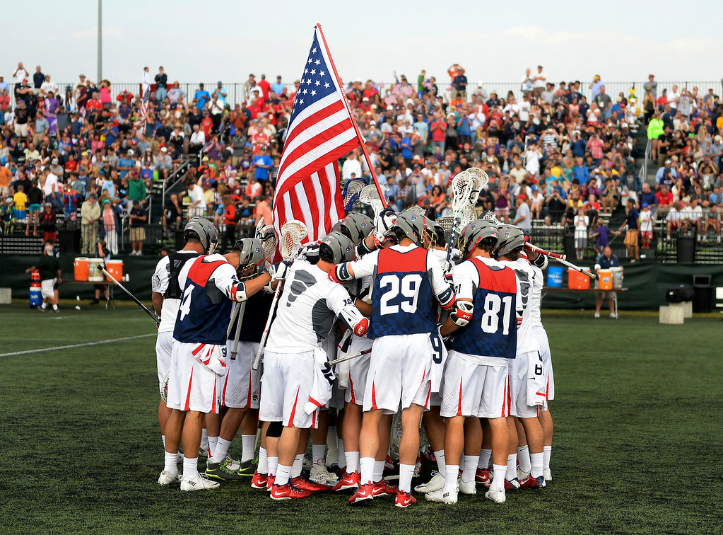 . The Americans huddled before the game. The United States took on the Iroquois Nationals Tuesday night, July 15, 2014.   Photo by Karl Gehring/The Denver Post