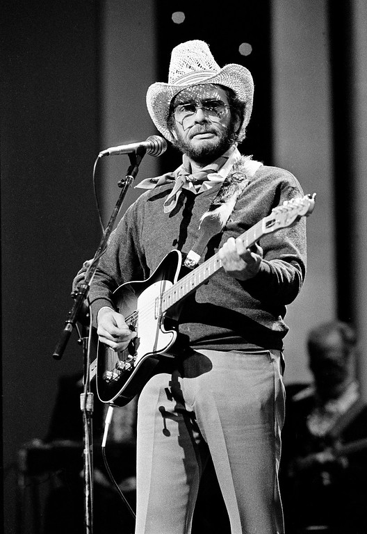 . In this Oct. 10, 1983 file photo, Merle Haggard performs at the Country Music Association Awards in Nashville, Tenn. Haggard died of pneumonia, Wednesday, April 6, 2016, in Palo Cedro, Calif. He was 79.  (AP Photo/Mark Humphrey, File)