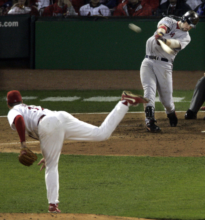 . Boston Red Sox\'s Trot Nixon hits an RBI single to left field off of St. Louis Cardinals pitcher Jeff Suppan scoring Red Sox\'s Bill Mueller in the fourth inning during Game 3 of the World Series at Busch Stadium in St. Louis, Tuesday, Oct. 26, 2004.  (AP Photo/Sue Ogrocki)