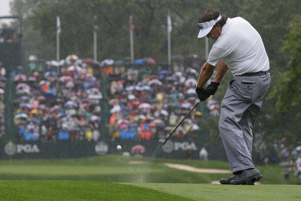 . Phil Mickelson hits his tee shot on the 18th hole during the second round of the PGA Championship golf tournament at Oak Hill Country Club, Friday, Aug. 9, 2013, in Pittsford, N.Y. (AP Photo/Charlie Neibergall)