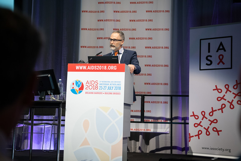 22nd International AIDS Conference (AIDS 2018) Amsterdam, Netherlands.   Copyright: Steve Forrest/Workers' Photos/ IAS  Photo shows: Michael Grulish, delivering a speech in memory of David Cooper, during the IAS Members' Meeting.