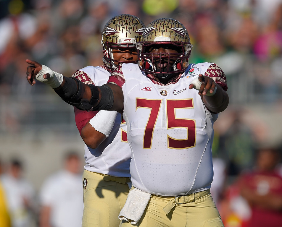 . Florida State offensive tackle Cameron Erving (75)  reacts in front of Florida State quarterback Jameis Winston, left, during the first half of the Rose Bowl NCAA college football playoff semifinal against Oregon, Thursday, Jan. 1, 2015 in Pasadena, Calif. (AP Photo/Mark J. Terrill)