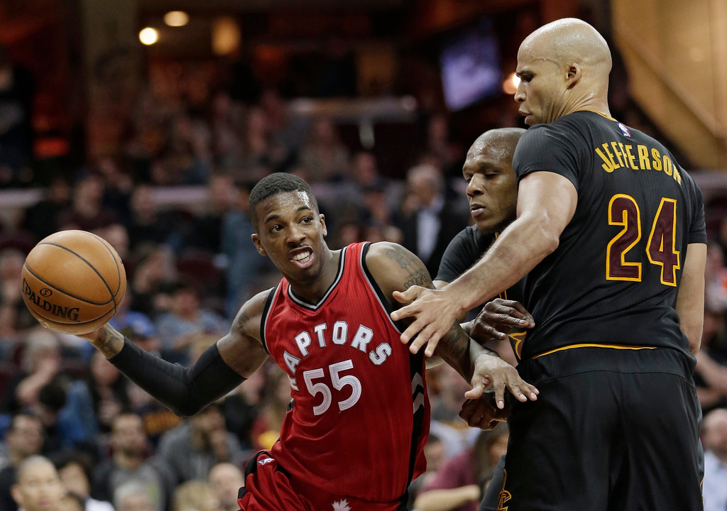 . Toronto Raptors\' Delon Wright, left to right, drives past Cleveland Cavaliers\' James Jones and Richard Jefferson in the second half of an NBA basketball game, Wednesday, April 12, 2017, in Cleveland. The Raptors won 98-83. (AP Photo/Tony Dejak)