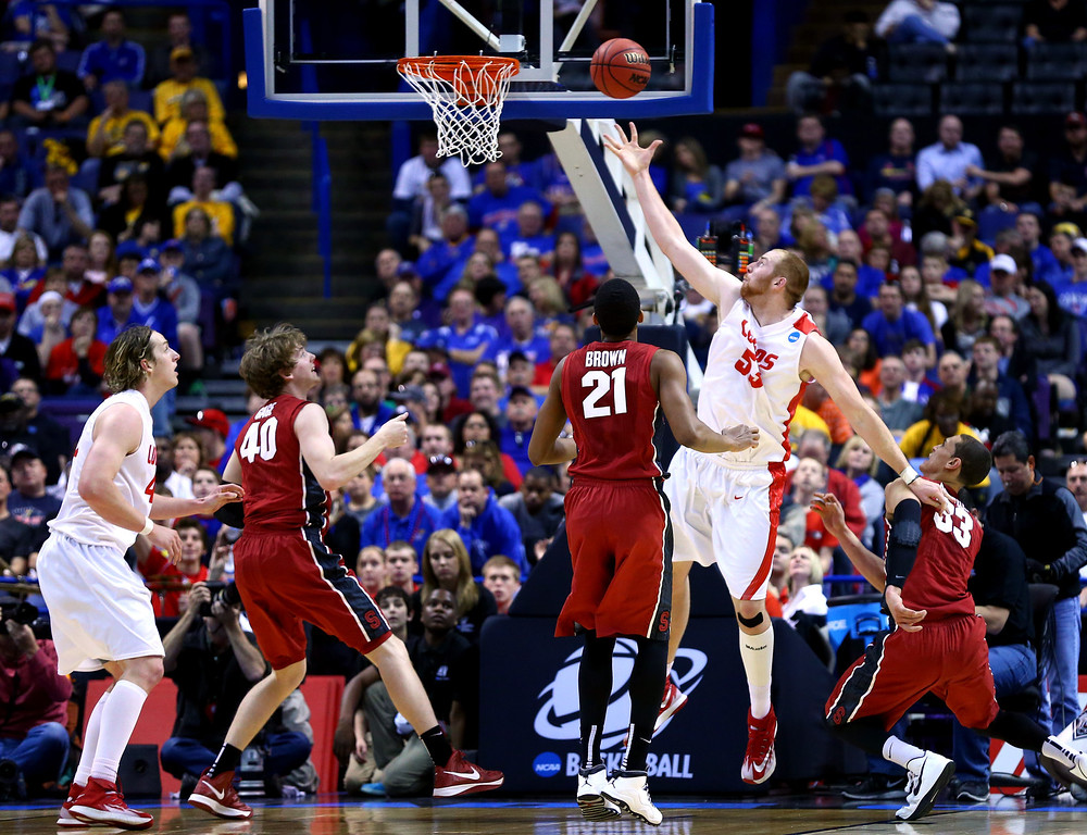 . Alex Kirk #53 of the New Mexico shoots the ball against John Gage #40 and Anthony Brown #21 of the Stanford Cardinal during the second round of the 2014 NCAA Men\'s Basketball Tournament at Scottrade Center on March 21, 2014 in St Louis, Missouri.  (Photo by Dilip Vishwanat/Getty Images)