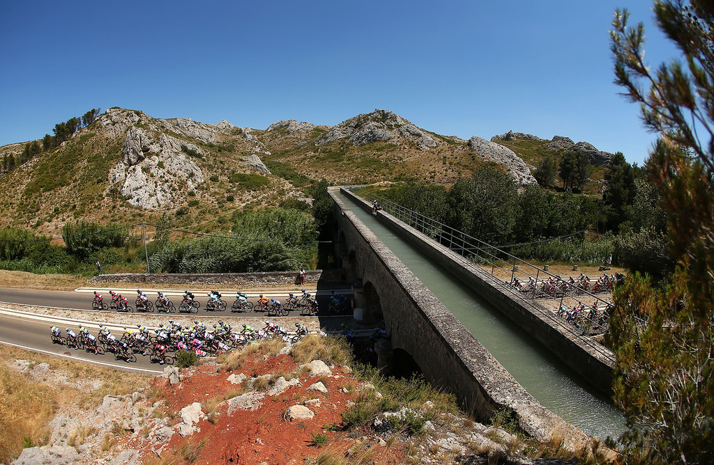 . MONTPELLIER, FRANCE - JULY 04:  The peloton passes beneath an aquaduct during stage six of the 2013 Tour de France, a 176.5KM road stage from Aix-en-Provence to Montpellier, on July 4, 2013 in Montpellier, France.  (Photo by Bryn Lennon/Getty Images)