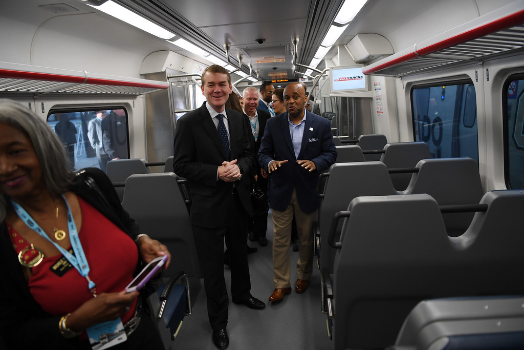 . Denver Mayor Michael Hancock tells U.S. Senator for Colorado Michael Bennet how smooth the new University of Colorado A-Line train is as it travels from Union Station to Denver International Airport, April 22, 2016. The line is 23 miles with 8 stations along the way. (Photo by RJ Sangosti/The Denver Post)