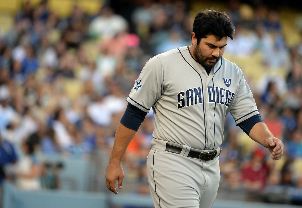 . San Diego Padres\' Carlos Quentin walks back to his position after striking out looking in the first inning of a Major league baseball game on Saturday, July 12, 2014 in Los Angeles.   (Keith Birmingham/Pasadena Star-News)