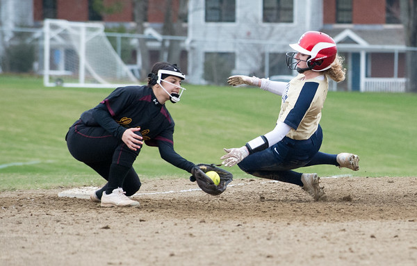 04/11/19 Wesley Bunnell | Staff New Britain softball defeated Newington on the road 4-1 on Thursday afternoon. Rachel Thureson (10) slides into third as Amanda Jacobs (5) fields and attempts the tag.