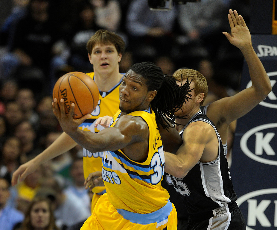 . Denver forward Kenneth Faried secured a rebound in the first half. The Denver Nuggets defeated the San Antonio Spurs 112-106 at the Pepsi Center Tuesday night, December 18, 2012. Karl Gehring/The Denver Post