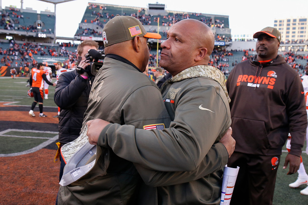 . Cincinnati Bengals head coach Marvin Lewis, left, and Cleveland Browns head coach Hue Jackson, right, meet on the field after an NFL football game, Sunday, Nov. 26, 2017, in Cincinnati. (AP Photo/Gary Landers)