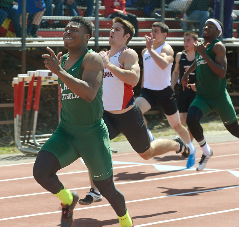 . Maribeth Joeright/MJoeright@News-Herald.com Lake Catholic\'s Masai McDaniel pushes through the final yards and wins the boys 100 meter dash during the Hilltopper Invitational track meet, April 12, 2014.