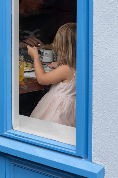 Girl eating breakfast at cafe, Kinsale, County Cork, Ireland