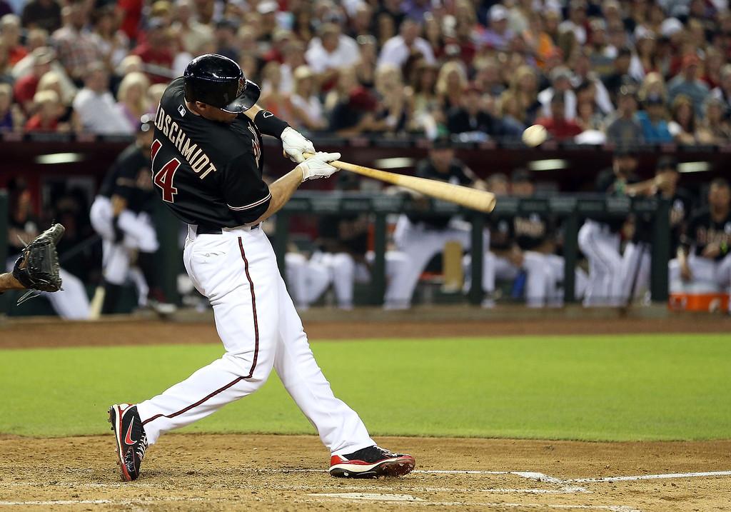 . PHOENIX, AZ - JULY 05:  Paul Goldschmidt #44 of the Arizona Diamondbacks hits a RBI single against the Colorado Rockies during the third inning of the MLB game at Chase Field on July 5, 2013 in Phoenix, Arizona.  (Photo by Christian Petersen/Getty Images)