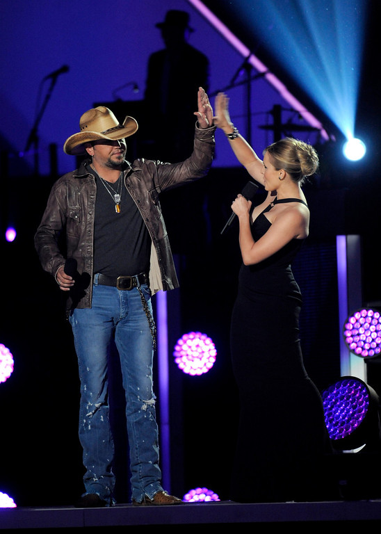 . Hosts Jason Aldean, left, and Kristen Bell speak on stage at the 2013 CMT Music Awards at Bridgestone Arena on Wednesday, June 5, 2013, in Nashville, Tenn. (Photo by Donn Jones/Invision/AP)