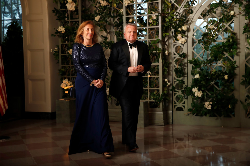 . John Sullivan, acting Secretary of State and Graciela Rodriguez arrive for a State Dinner with French President Emmanuel Macron and President Donald Trump at the White House, Tuesday, April 24, 2018, in Washington. (AP Photo/Alex Brandon)