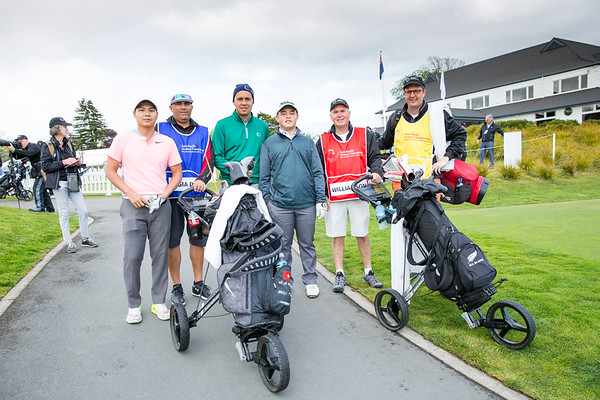 Do Le Gia Dat from Vietnam, Kristopher Williamson from Cook Islands and Brentt Salas from Guam with their caddies after hitting off the 1st tee on Day 1 of competition in the Asia-Pacific Amateur Championship tournament 2017 held at Royal Wellington Golf Club, in Heretaunga, Upper Hutt, New Zealand from 26 - 29 October 2017. Copyright John Mathews 2017.   www.megasportmedia.co.nz