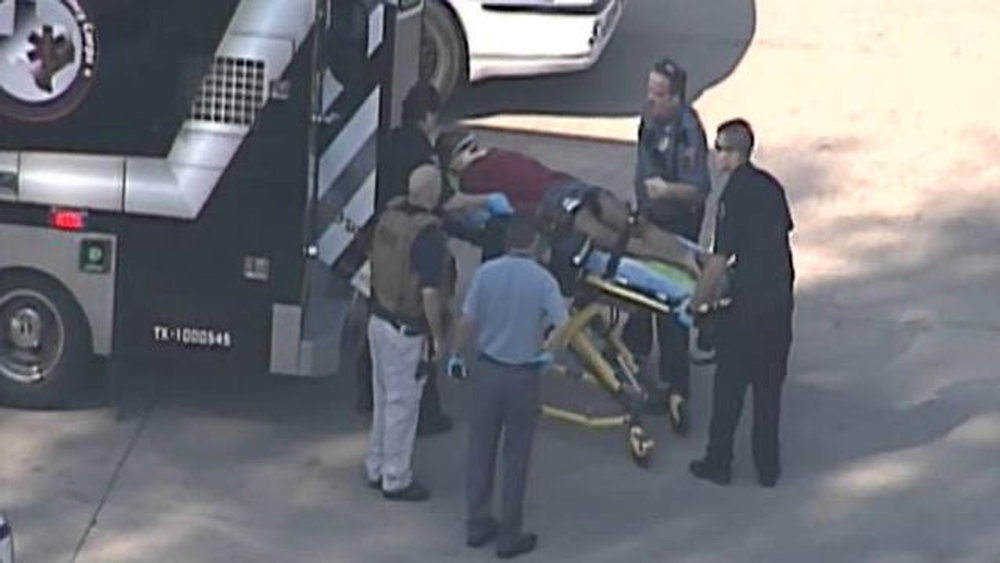 Description of . Police and emergency personnel evacuate an injured male on a stretcher outside a building on the Lone Star College Campus near Houston, Texas in this still image taken from video courtesy of KPRC-TV Houston January 22, 2013.  Multiple people have been shot according to news reports.  REUTERS/KPRC-TV Houston/Handout
