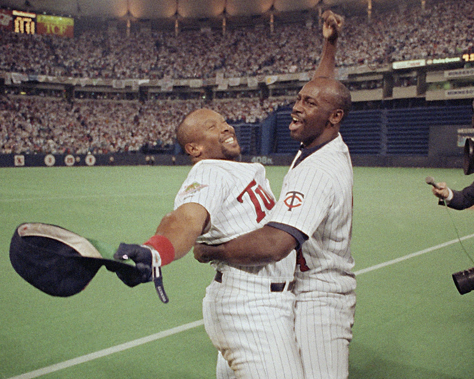 . Minnesota Twins outfielder Kirby Puckett, left, celebrates with designated hitter Chili Davis after the Twins won the World Series at the Metrodome in Minneapolis on October 28, 1991. (AP Photo/Jim Mone)