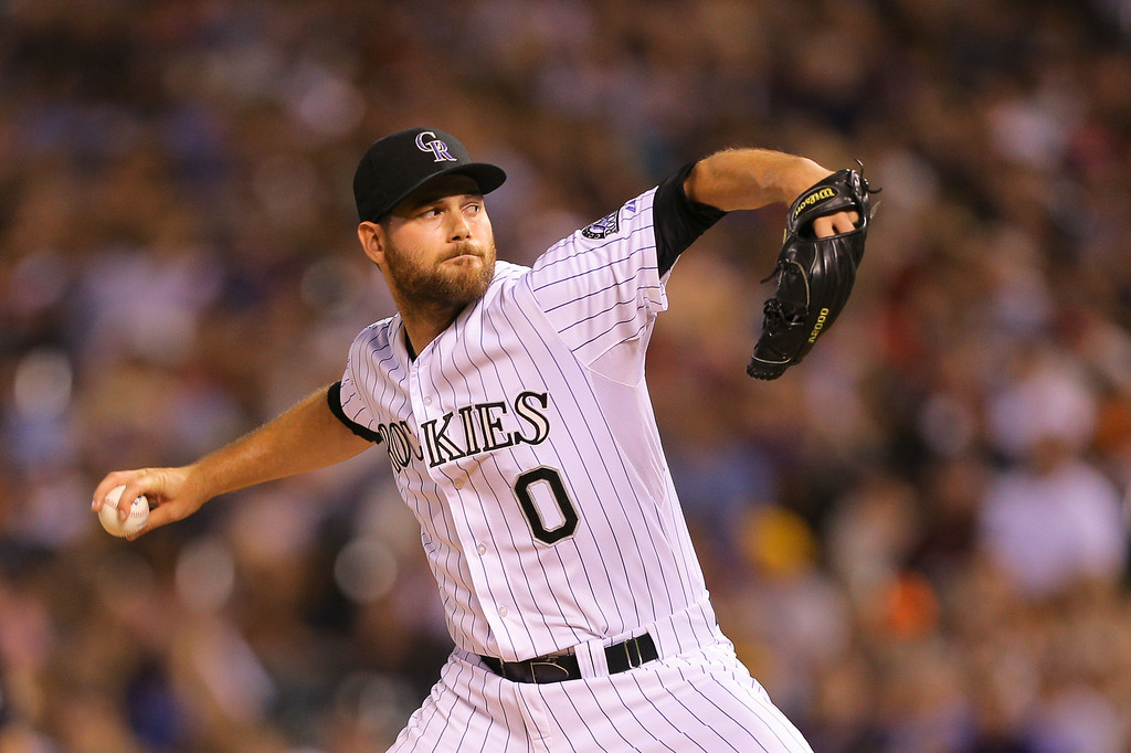 . DENVER, CO - JULY 11: Relief pitcher Adam Ottavino #0 of the Colorado Rockies delivers to home plate during the seventh inning against the Minnesota Twins at Coors Field on July 11, 2014 in Denver, Colorado. The Rockies defeated the Twins 6-2. (Photo by Justin Edmonds/Getty Images)