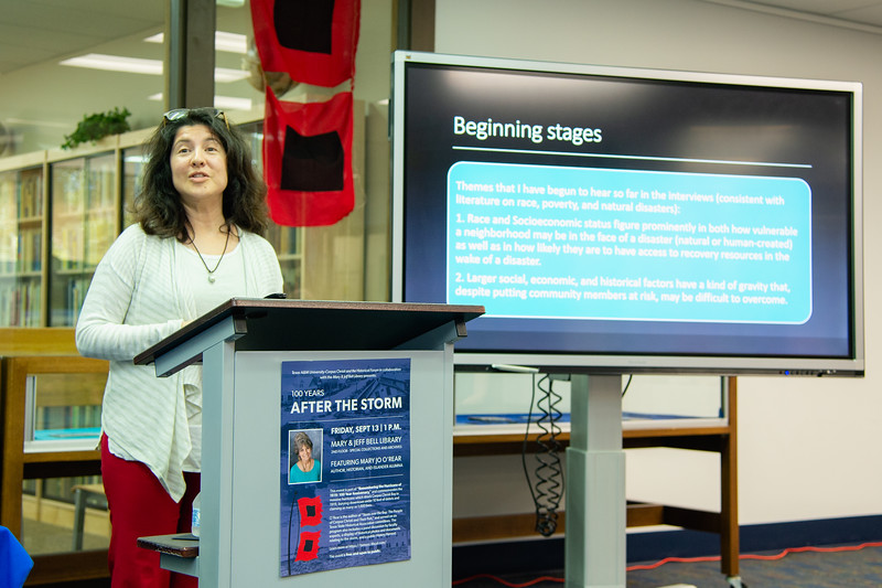 "Dr. Lisa Comparini gives her presentation during the ""100 Years After The Storm"" forum."