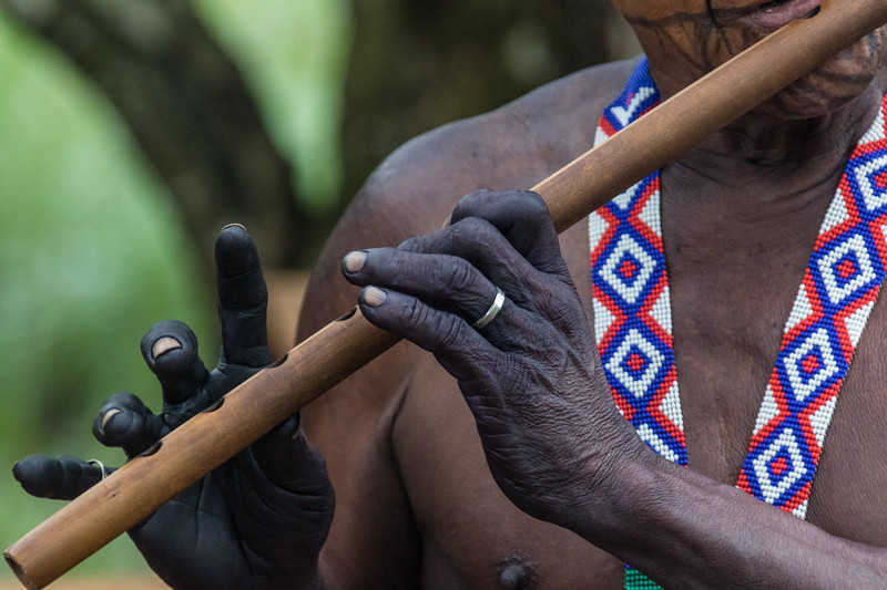 A member of the Embera tribe of Panama plays a flute